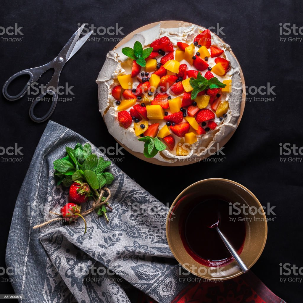 Pavlova cake on dark background. Top view. From above. stock photo