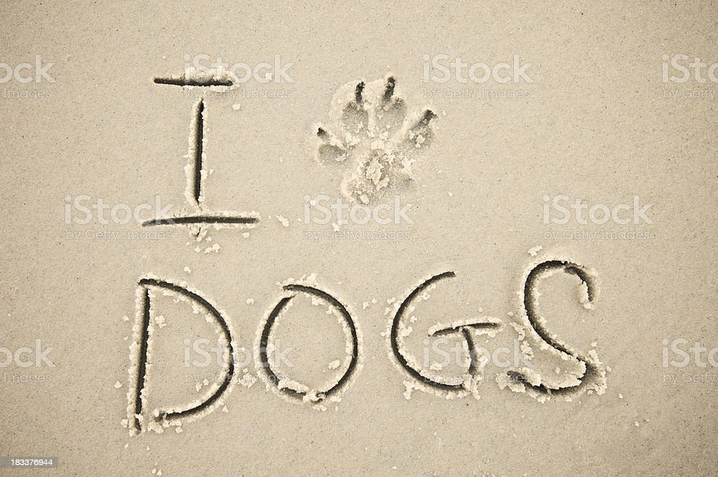 I Paw Print Dogs Message in Sand royalty-free stock photo