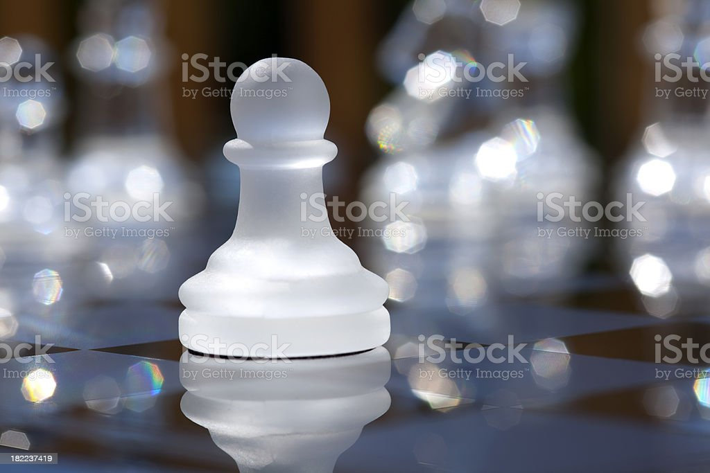 Pawn Isolated on Sparkling Chess Board royalty-free stock photo