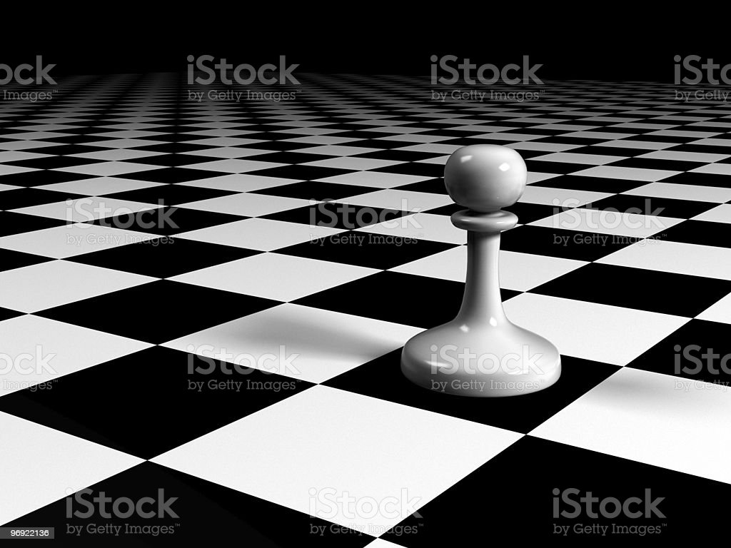 pawn on a huge chessboard stock photo