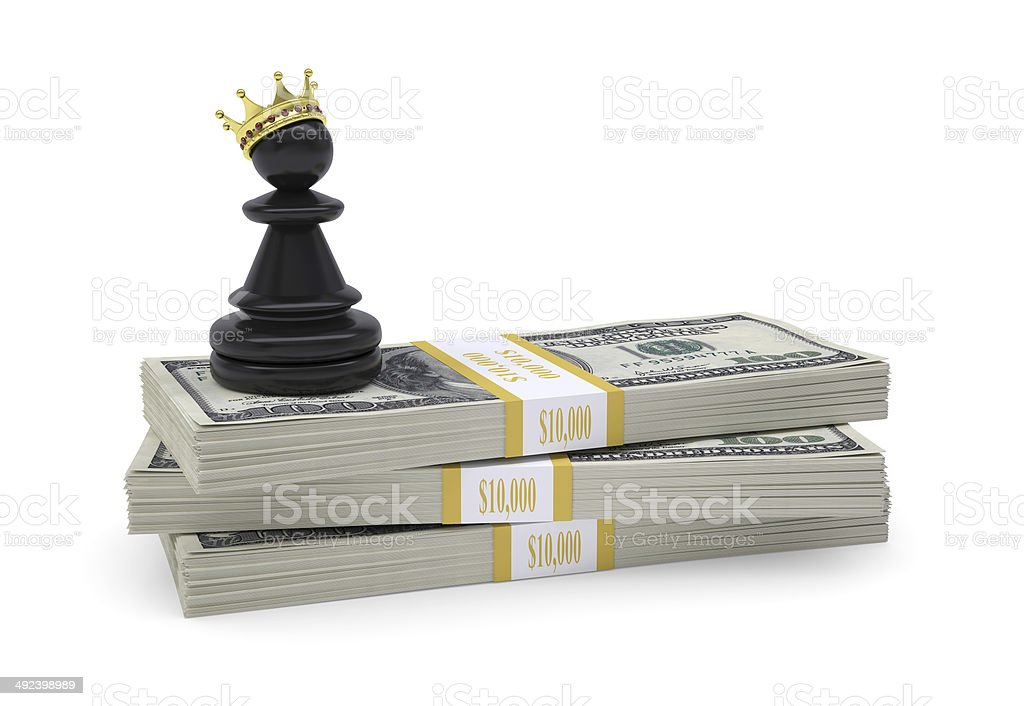 Pawn with gold crown stand on pack of dollars stock photo
