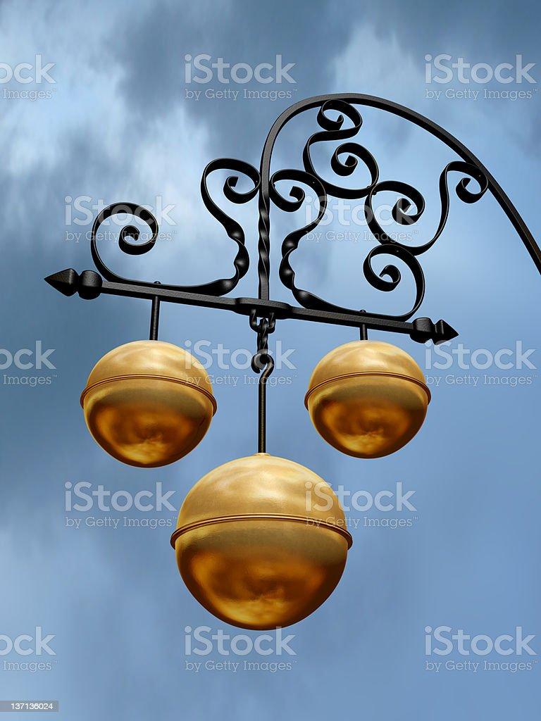Pawnbroker symbol with three gold balls on black hanger stock photo