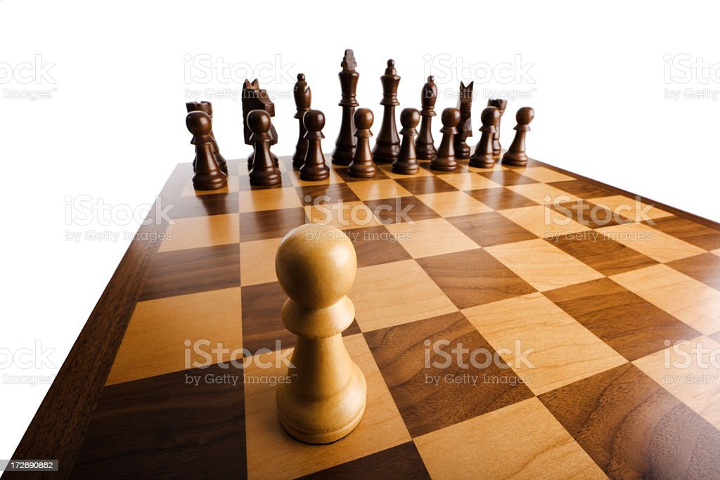 Pawn's Nightmare, Facing Chess Pieces on Board in Threatening Perspective royalty-free stock photo