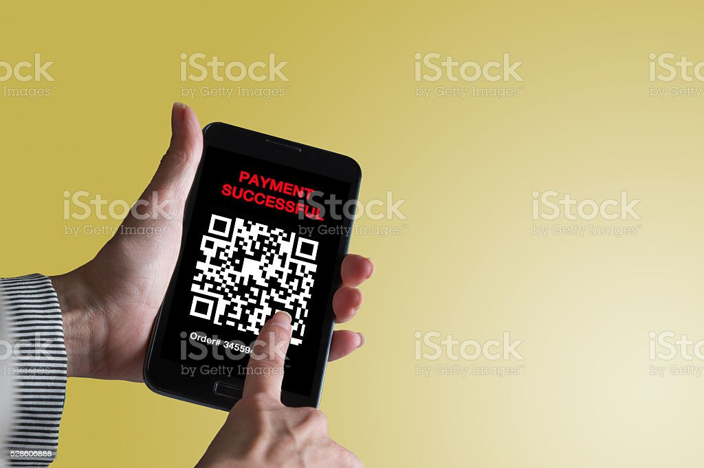 Pay by scanning your QR code with smartphone. stock photo
