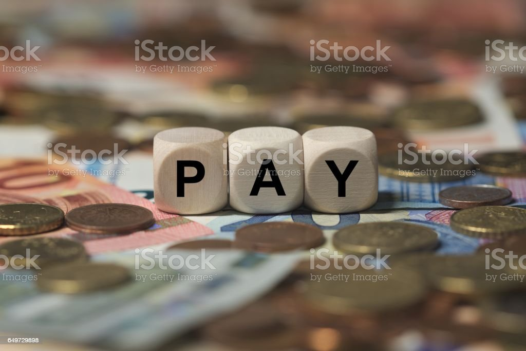 pay - cube with letters, money sector terms - sign with wooden cubes stock photo