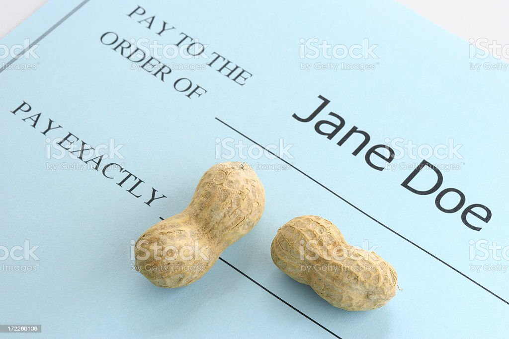 Pay Exactly Peanuts! stock photo