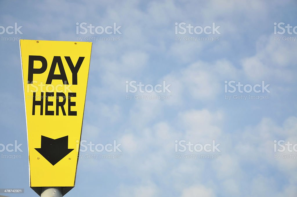 Pay Here Sign royalty-free stock photo