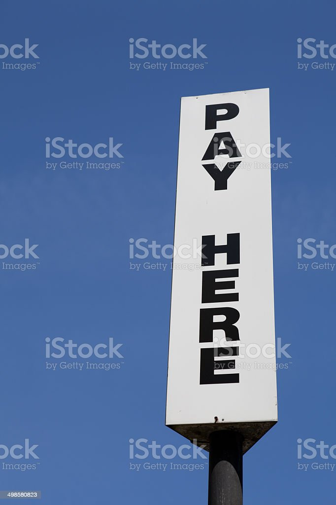 Pay Here Sign stock photo