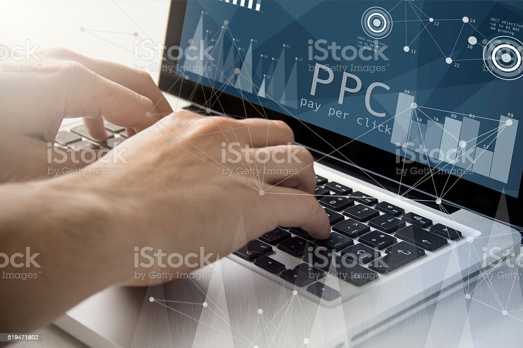 pay per click techie working stock photo