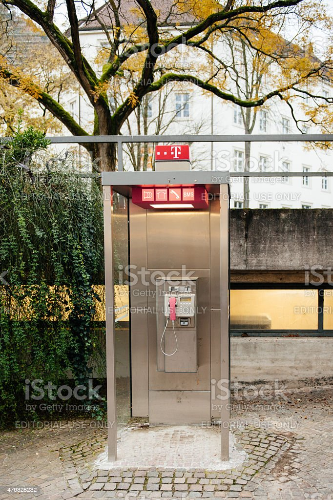 pay phone booth in Germany stock photo