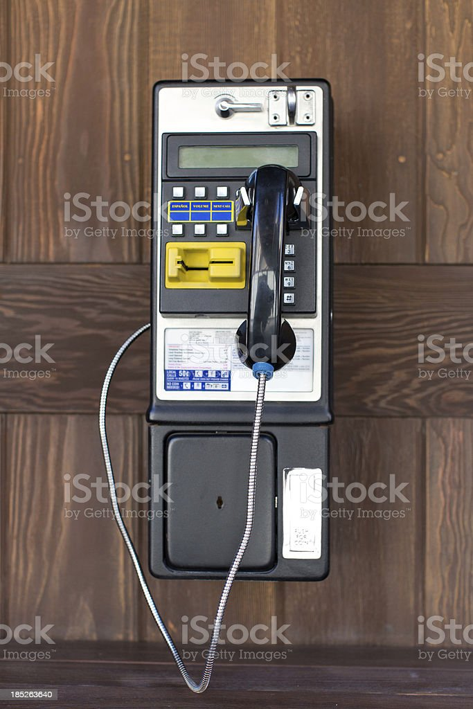 pay phone on wood background royalty-free stock photo