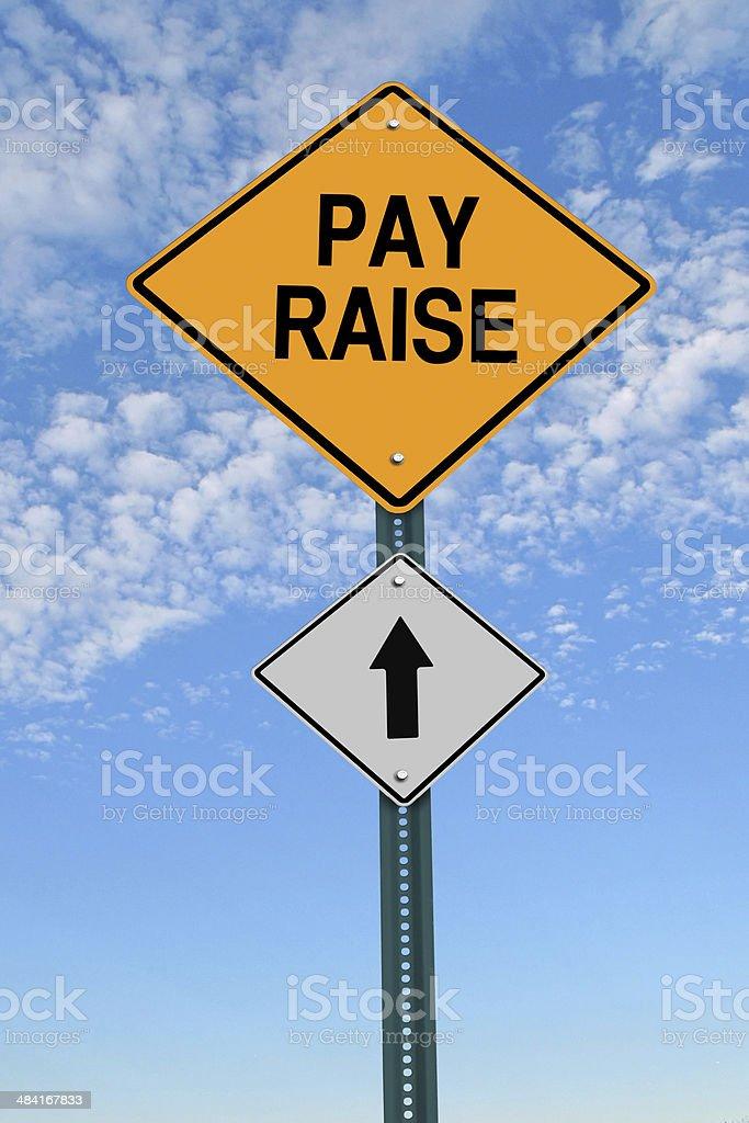 pay raise ahead roadsign stock photo
