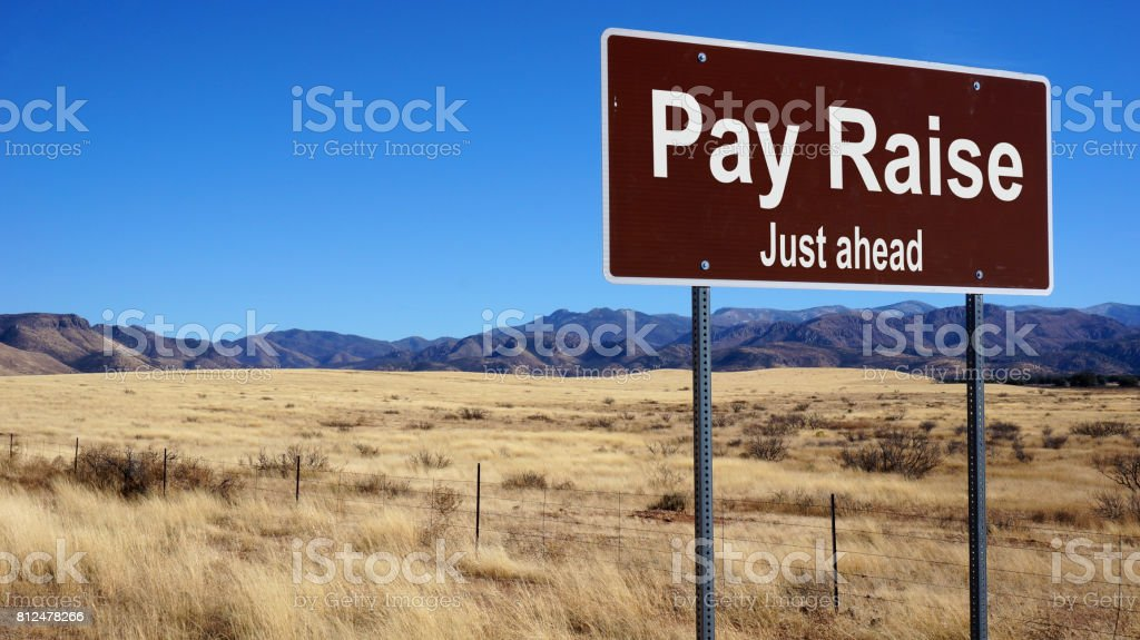 Pay Raise road sign stock photo