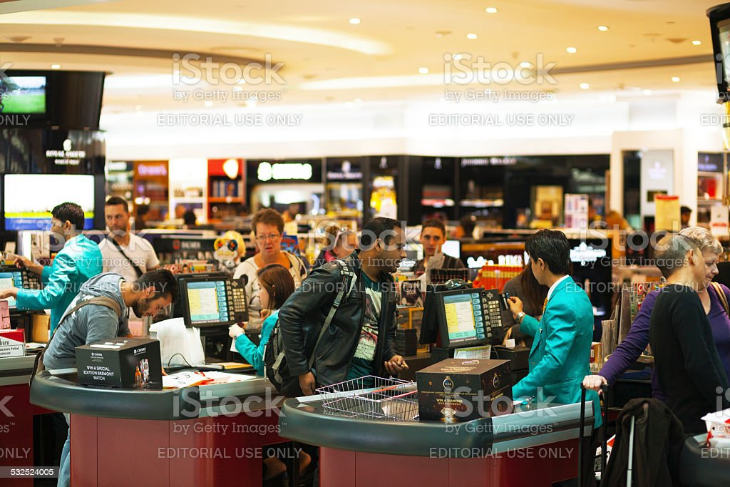 Paying at duty free caisse stock photo