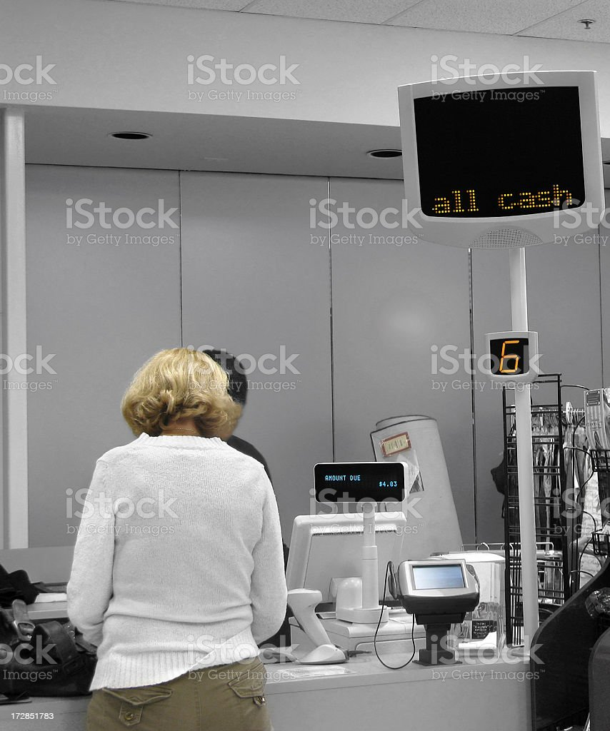 Paying at the cash register royalty-free stock photo