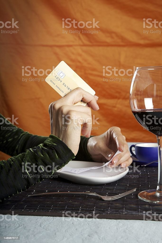paying bill with credit card at restaurant stock photo