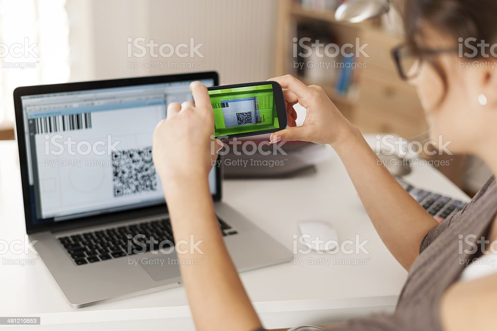 Paying bills by scanning qr code is faster and easier stock photo
