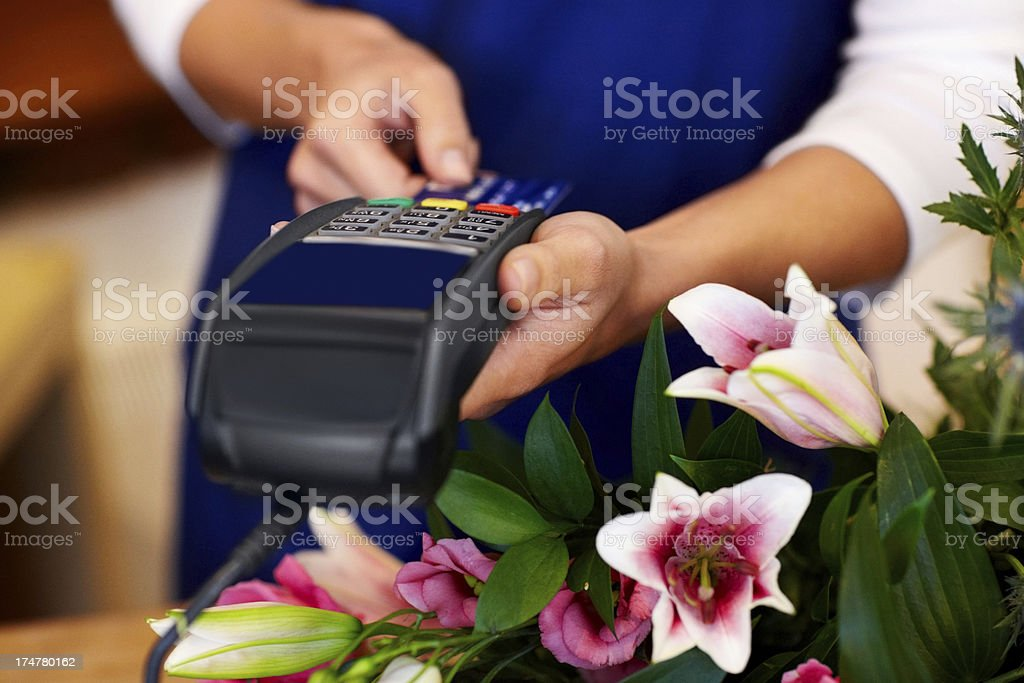 Paying by credit card at florist stock photo