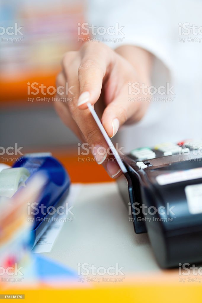Paying by credit card at the pharmacy stock photo