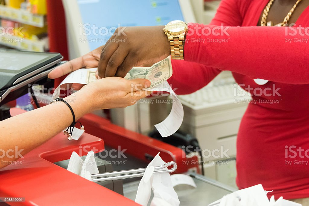Paying cash stock photo