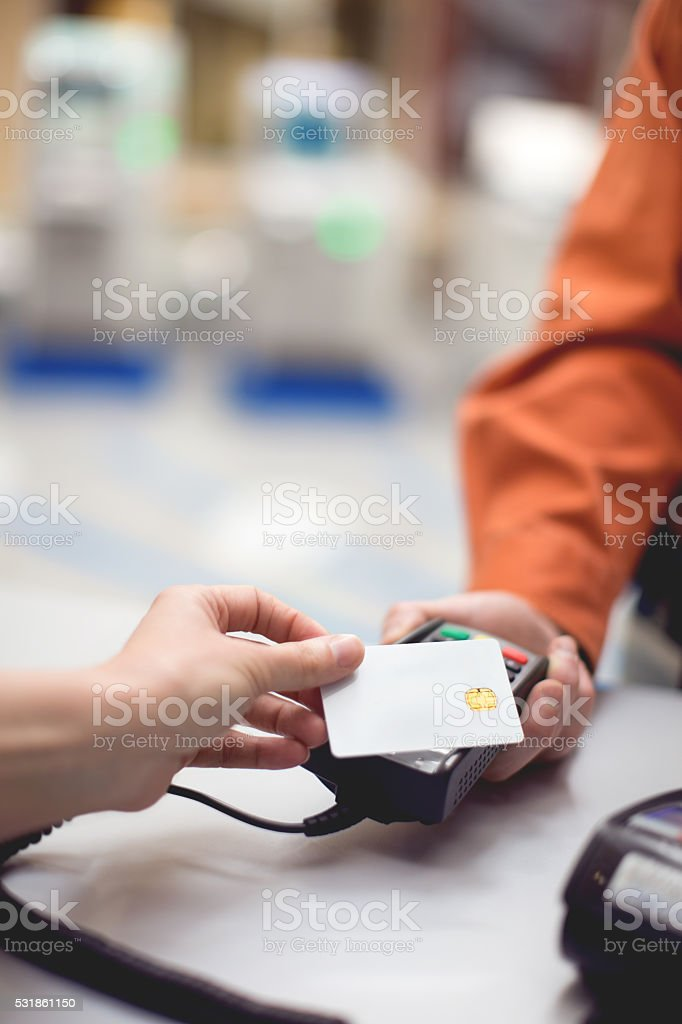Paying contactless using credit card stock photo