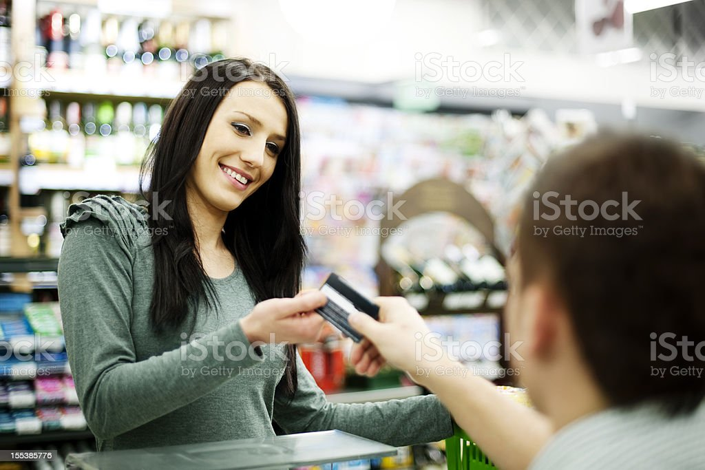 Paying credit card for purchases stock photo