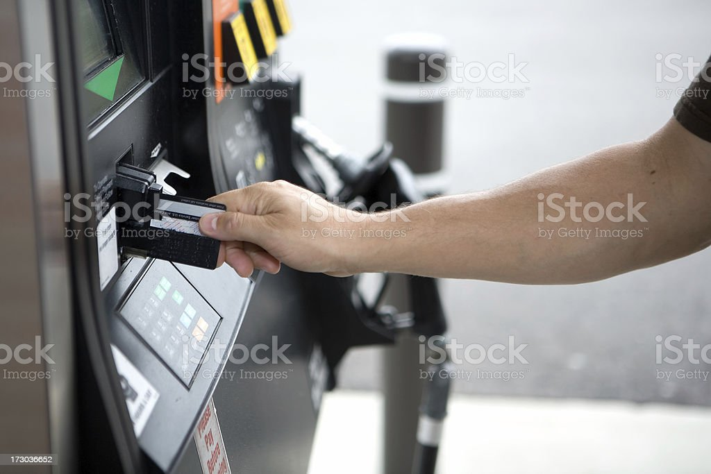 paying for gas royalty-free stock photo