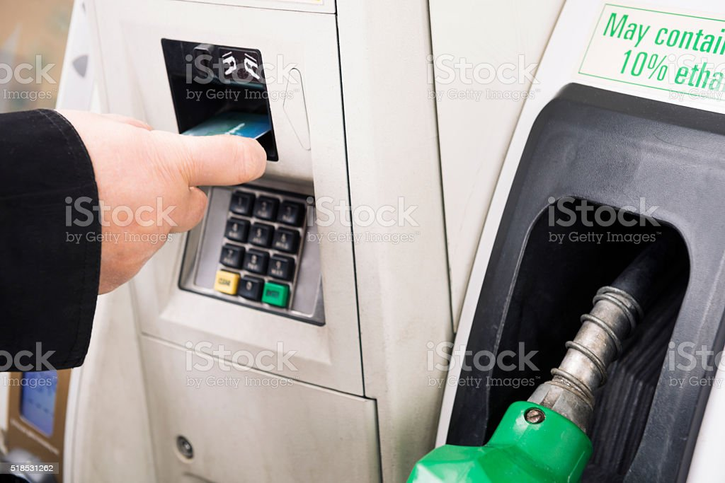 paying for gas stock photo