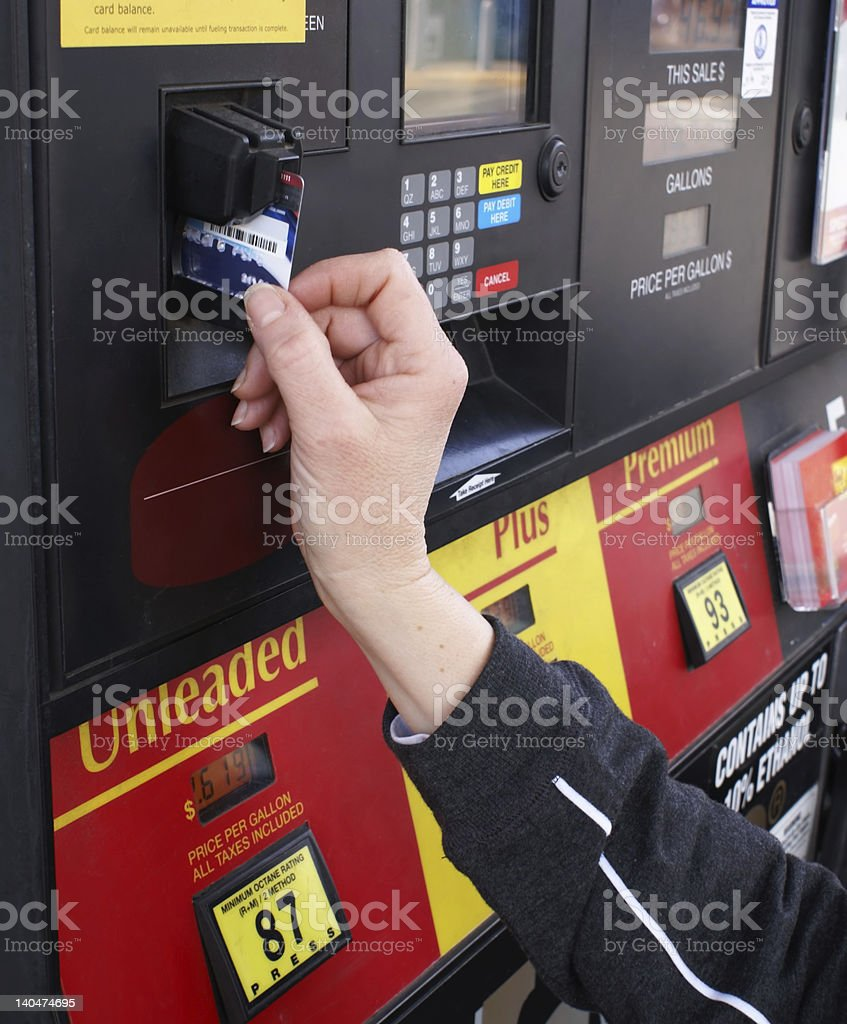 Paying for gas with a credit card stock photo