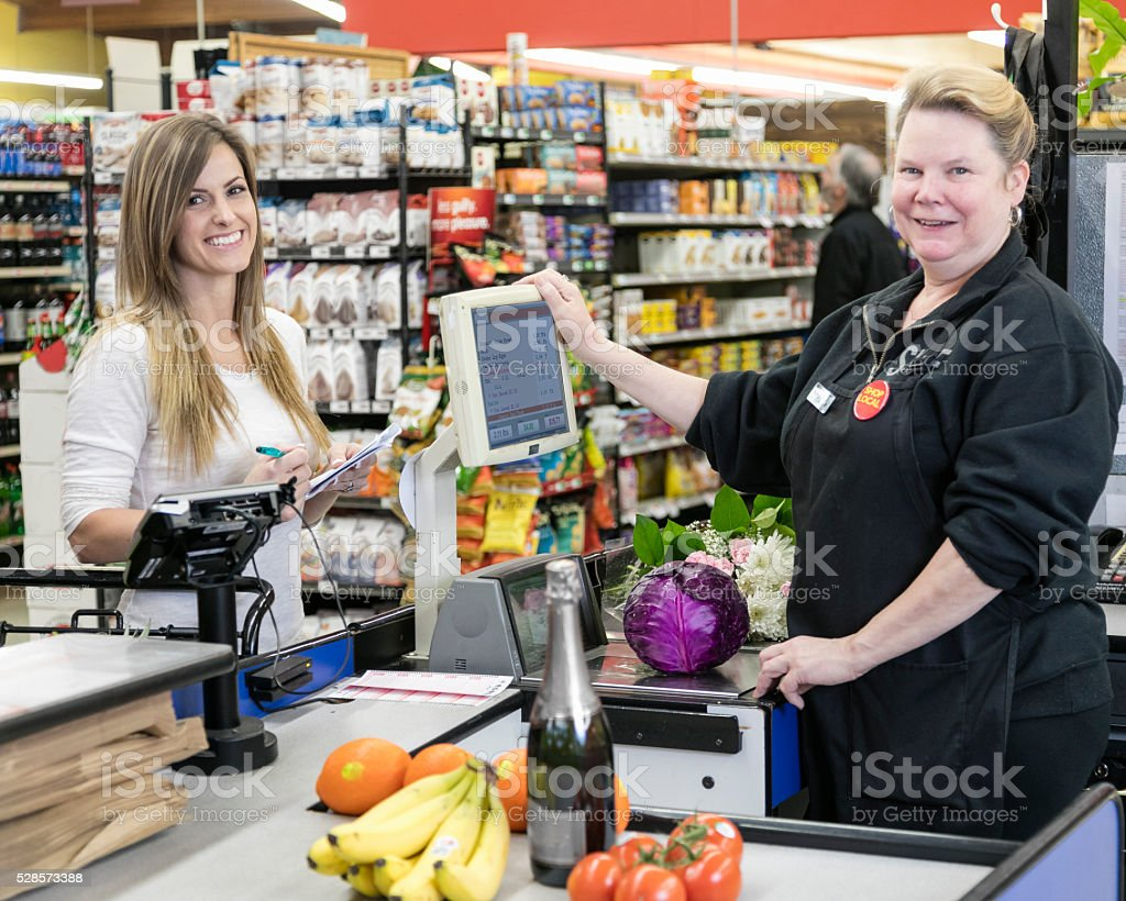 Paying for Groceries stock photo