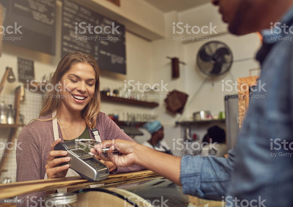 Paying for his purchases conveniently and securely stock photo