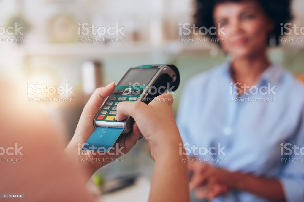 Paying for juice by credit card reader stock photo
