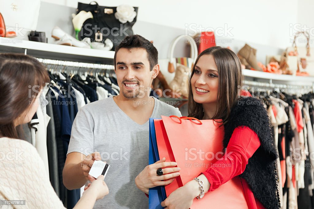 Paying for new clothes royalty-free stock photo