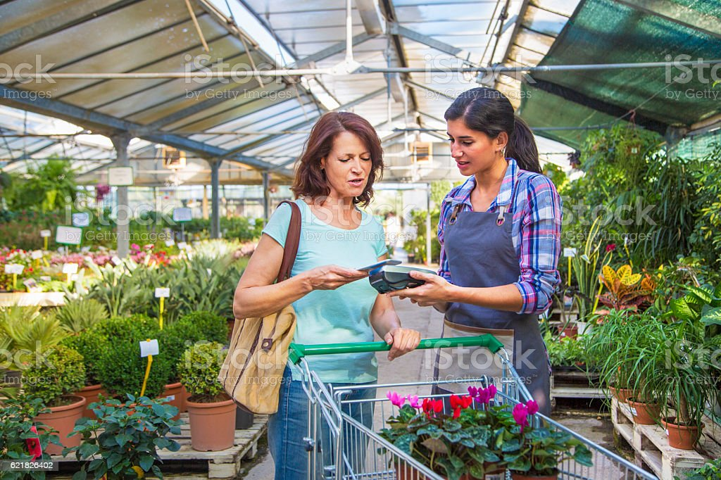 Paying for plants with contactless payment stock photo