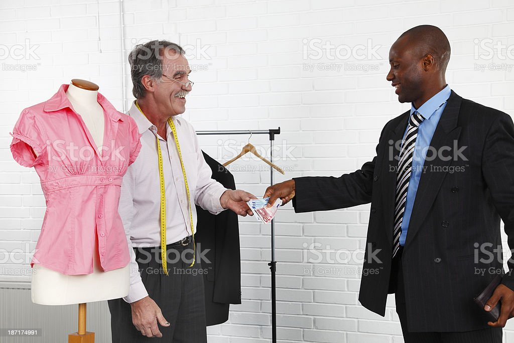 Paying for the suit royalty-free stock photo