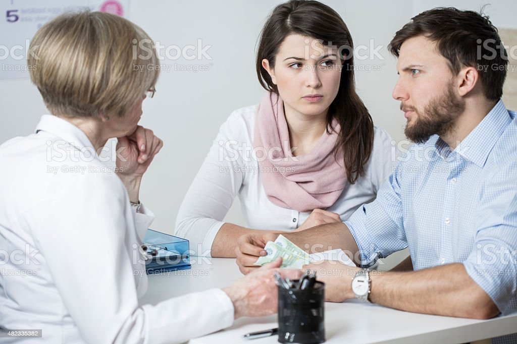 Paying for visit stock photo
