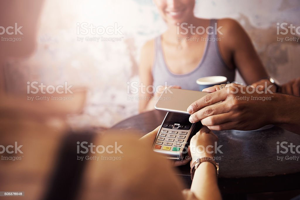 Paying for your coffee just got more convenient stock photo