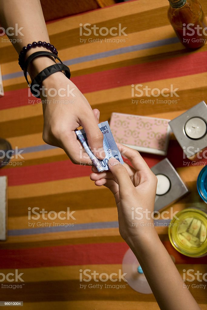 Paying gesture stock photo