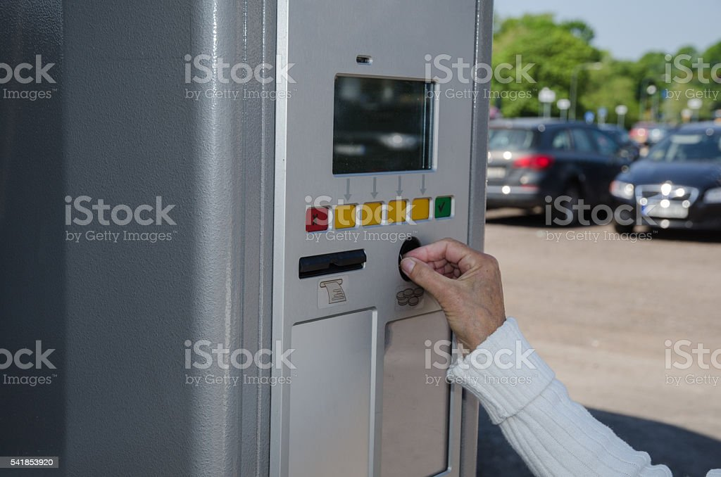 Paying in a parking automate stock photo