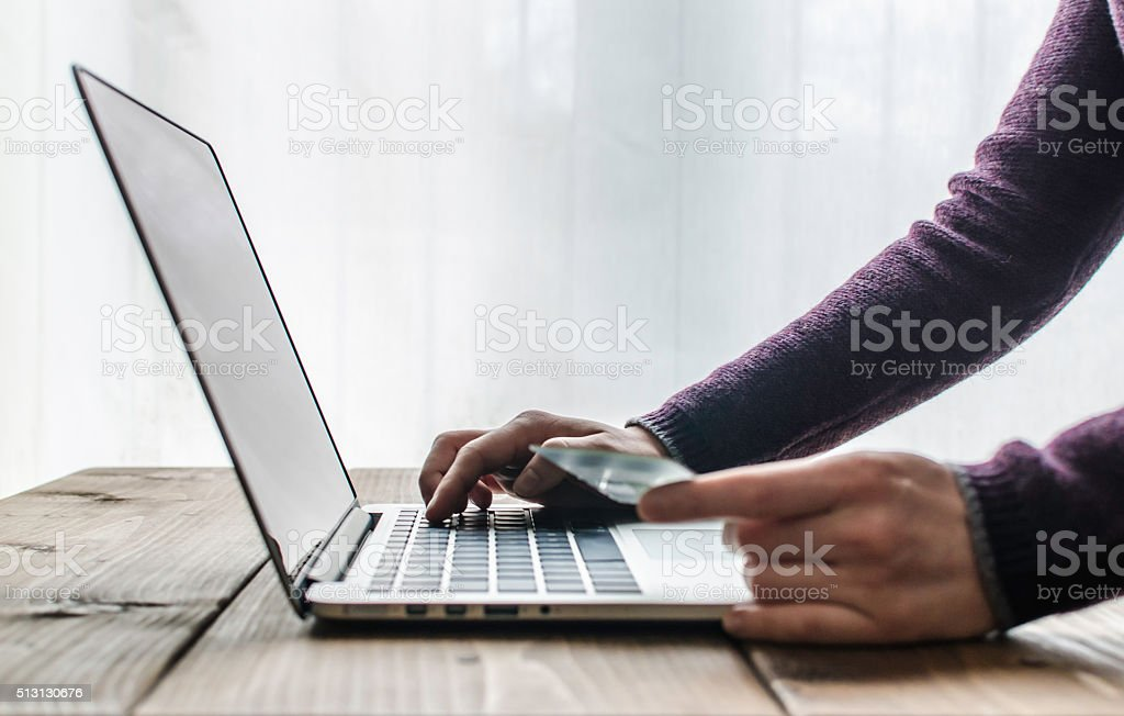 Paying online with a credit card stock photo