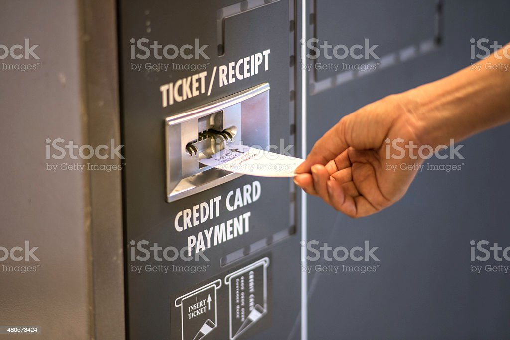 Paying parking Ticket at airport stock photo