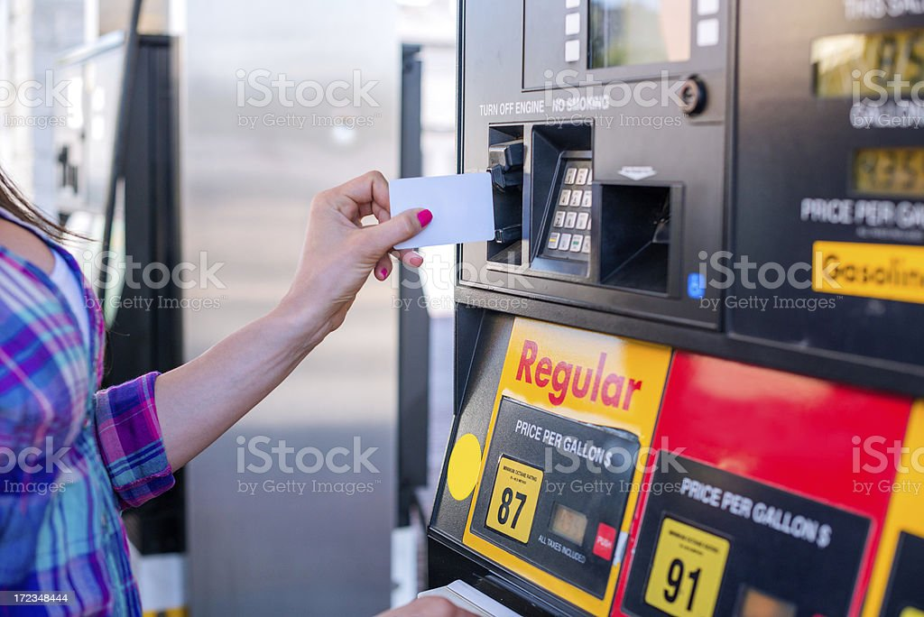 Paying the fuel stock photo