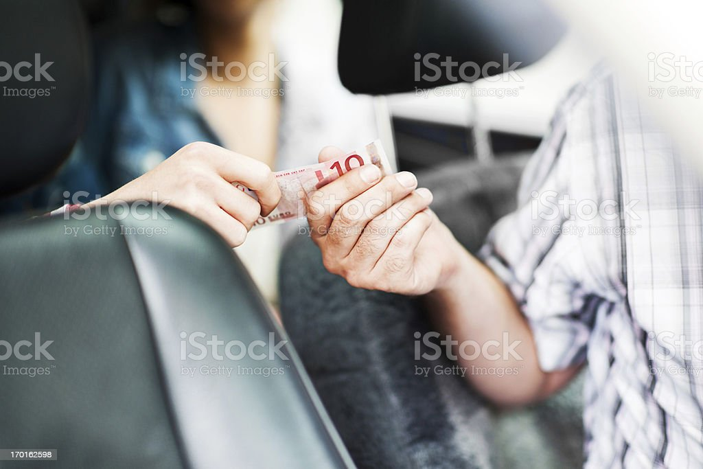 Paying the taxi. stock photo