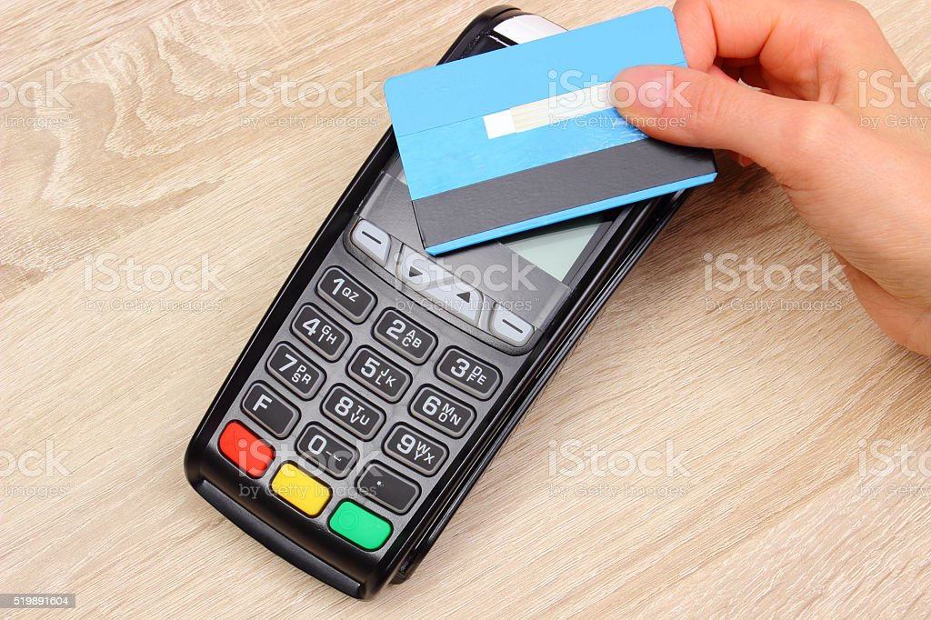 Paying with contactless credit card with NFC technology stock photo