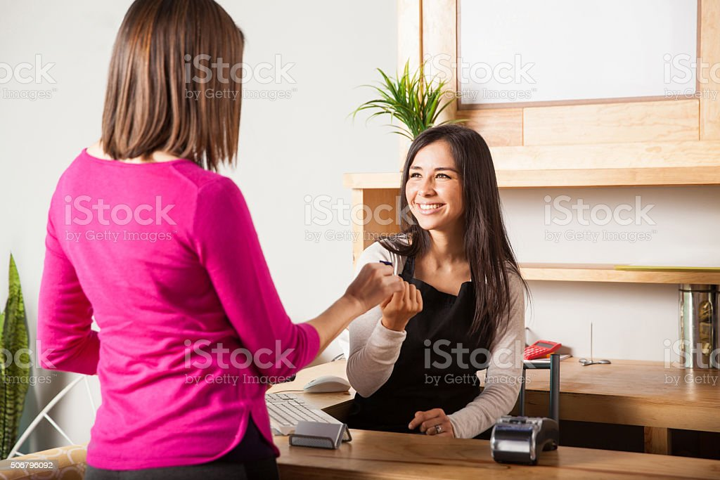 Paying with credit card at a store stock photo