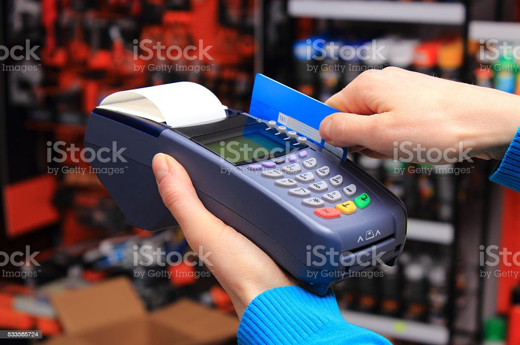 Paying with credit card in an electrical shop, finance concept stock photo