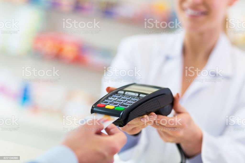 Paying with credit card in drugstore stock photo