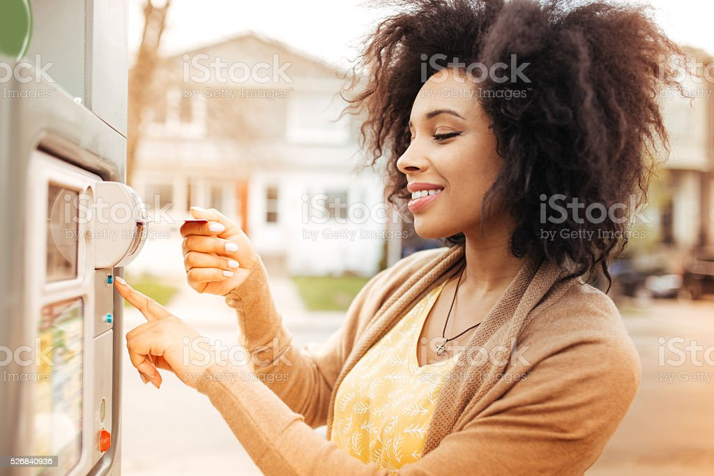 Paying with credit card on parking meter stock photo