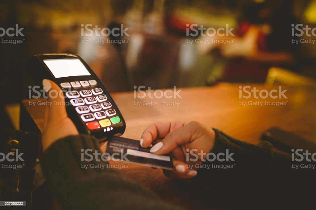 Paying with credit card on terminal stock photo