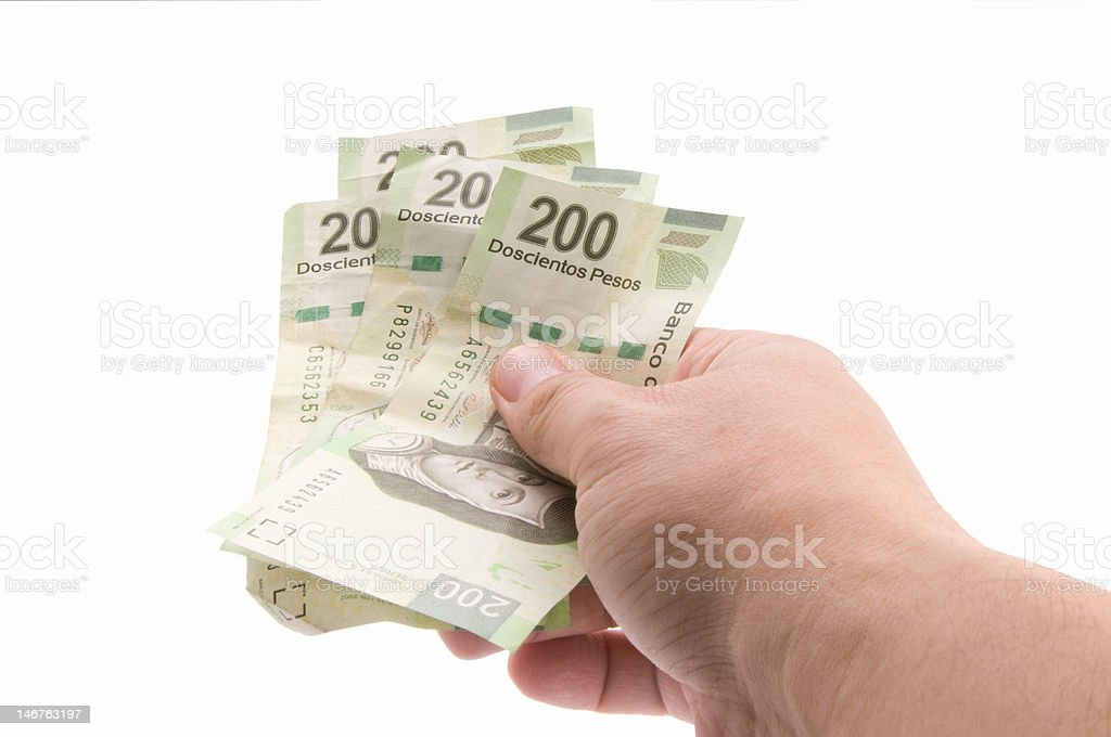 Paying with Pesos stock photo
